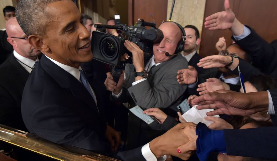 President Barack Obama shakes hands after delivering the State of the Union address before a joint session of Congress on Tuesday, Jan. 20, 2015, on Capitol Hill in Washington. (AP Photo/Mandel Ngan, Pool)