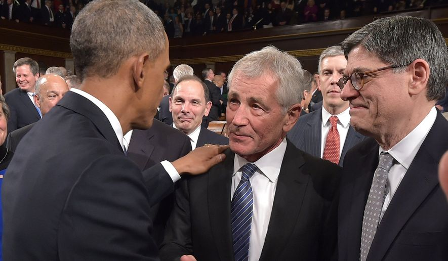 US President Barack Obama shakes hands with US Secreatry of Defense Chuck Hagel (C) as Secretary of the Treasury Jacob Lew (R) watches after Obama delivered the State of The Union address on January 20, 2015, at the US Capitol in Washington, DC. AFP PHOTO/POOL/MANDEL NGAN
