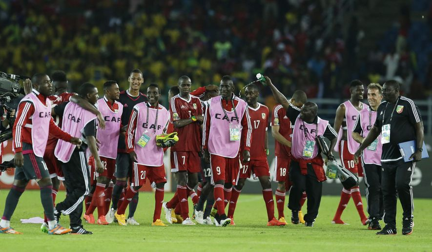 Congo's soccer players celebrate after winning their African Cup of Nations Group A soccer match against Gabon in Bata, Equatorial Guinea, Wednesday, Jan. 21, 2015. (AP Photo/Themba Hadebe)