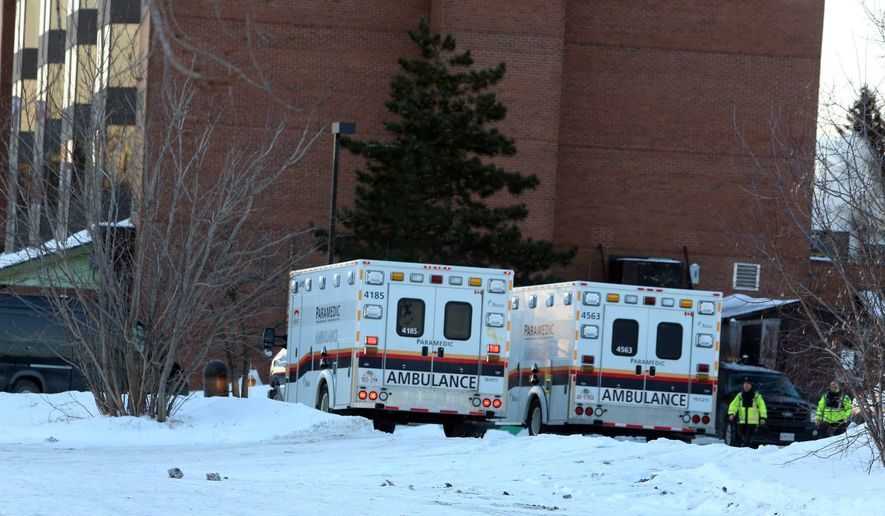 Ambulances and police are shown at the scene of a evacuation and police investigation at the Chimo Hotel in Ottawa on Wednesday, Jan. 21, 2015.  A 42-year-old man was arrested at the hotel Wednesday following an overnight police investigation linked to the discovery of dangerous chemicals 870 miles away in the Halifax area of Nova Scotia. Authorities evacuated two Halifax neighborhoods and the Ottawa hotel, and the suspect was arrested after negotiations with police, said Ottawa Const. Chuck Benoit. (AP Photo/The Canadian Press, Fred Chartrand)