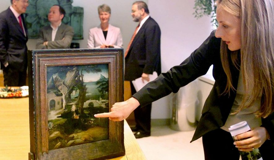 "FILE - In this May 24, 2001, file photo, Charlene von Saher points to the painting once owned by her grandfather titled, ""The Temptation of St. Anthony,"" in New York. The painting is part of an extensive collection of Old Master art that was stolen by the Nazis in Holland 60 years ago. This piece is the first to be returned to the original family. The Norton Simon Museum will return to court in a long-running legal battle with a New York woman who says two of the institution's most valuable paintings were wrongly taken from her family by the Nazis during World War II. (AP Photo/Ed Bailey, File)"