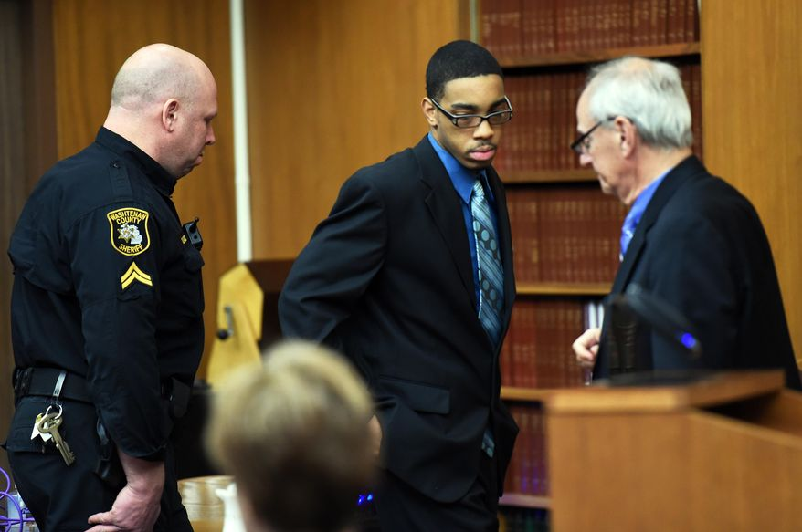 Joei Jordan, one of three defendants, is led into court for his his trial in the 2013 fatal shooting of University of Michigan medical student Paul DeWolf, Wednesday, Jan. 21, 2015 at the Washtenaw County Trial court in Ann Arbor, Mich.  (AP Photo/The Ann Arbor News, Melanie Maxwell)