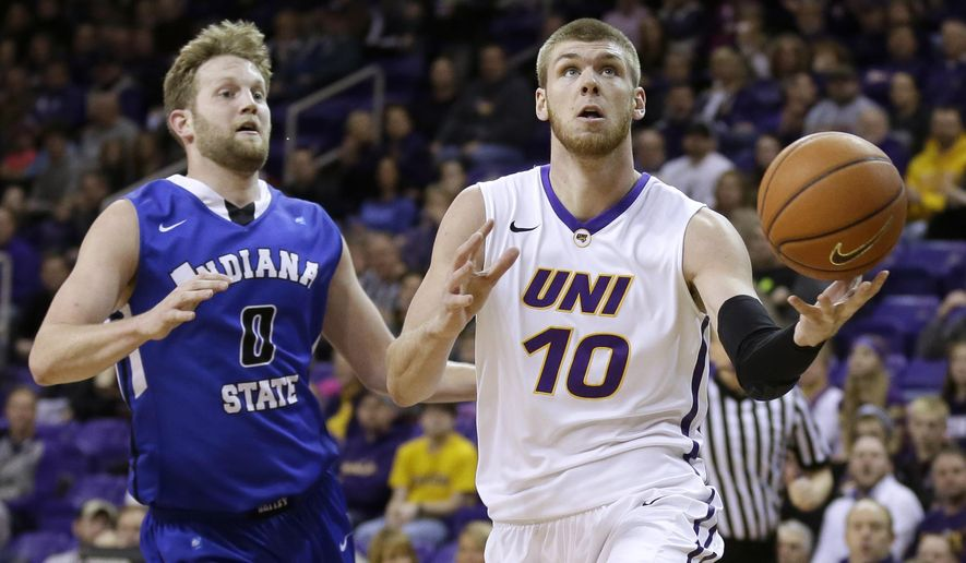 Northern Iowa forward Seth Tuttle, right, drives to the basket past Indiana State forward Jake Kitchell during the first half of an NCAA college basketball game, Wednesday, Jan. 21, 2015, in Cedar Falls, Iowa. (AP Photo/Charlie Neibergall)