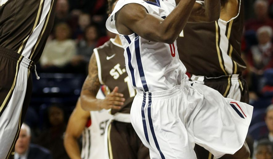"In this photo taken Jan. 11, 2015, Richmond's Kendall Anthony drives between two St. Bonaventure defenders on his way to the basket during the first half of an NCAA college basketball game in Richmond, Va. Opponents have used words like ""unguardable"" and ""impossible to contain"" when describing Kendall Anthony. Not bad for a 5-foot-8 speed demon and the Spiders' career 3-point leader (AP Photo/Richmond Times-Dispatch, Dean Hoffmeyer)"
