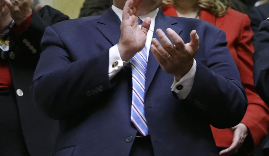 New Jersey Gov. Chris Christie applauds from the gallery before watching Larry Hogan take the oath of office to become the 62nd governor of Maryland inside the state senate chamber, Wednesday, Jan. 21, 2015, in Annapolis, Md. (AP Photo/Patrick Semansky, Pool)