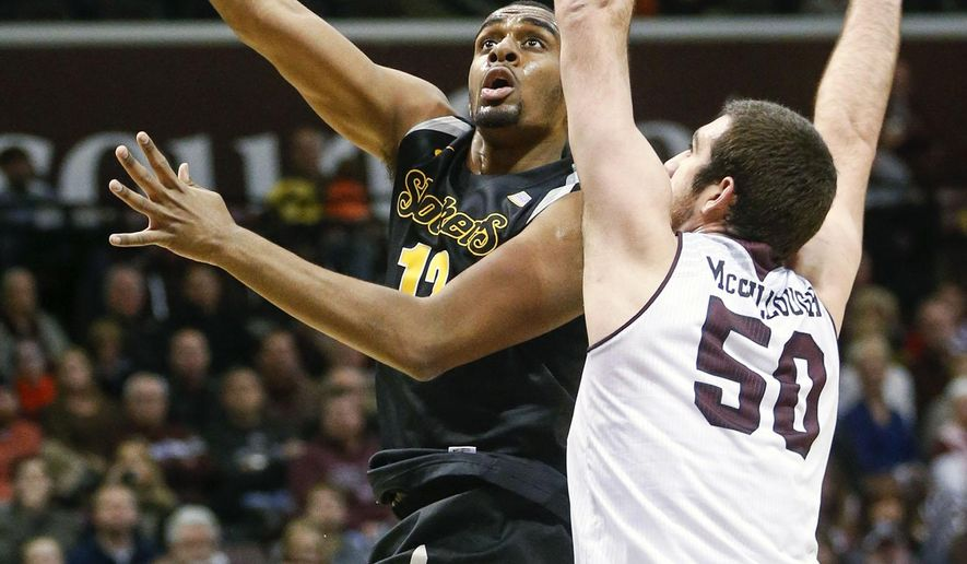 Wichita State's Darius Carter , left, goes up for two points against Missouri State's Tyler McCullough (50) during the first half of an NCAA college basketball game, Wednesday, Jan. 21, 2015 in Springfield, Mo. (AP Photo/The Wichita Eagle, Fernando Salazar) LOCAL TELEVISION OUT; MAGS OUT; LOCAL RADIO OUT; LOCAL INTERNET OUT