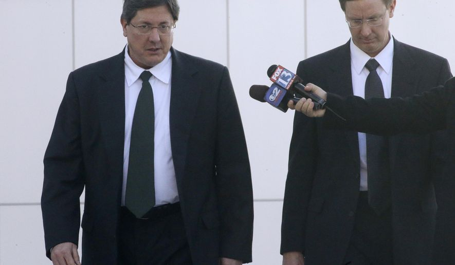 Nephi, right, and Lyle Jeffs leave the federal courthouse in Salt Lake City, Wednesday, Jan. 21, 2015. A federal judge says the brothers of polygamous sect leader Warren Jeffs can cite their religion in refusing to answer questions about suspected child labor violations on a Utah pecan farm. Nephi and Lyle Jeffs, who are considered high-ranking members of the secretive sect, testified that their church doctrine bars them from talking about the group's dealings. (AP Photo/Rick Bowmer)