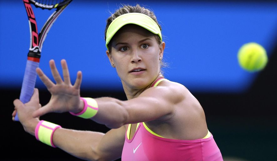 Eugenie Bouchard of Canada makes a forehand return to Kiki Bertens of the Netherlands during their second round match at the Australian Open tennis championship in Melbourne, Australia, Wednesday, Jan. 21, 2015. (AP Photo/Bernat Armangue)