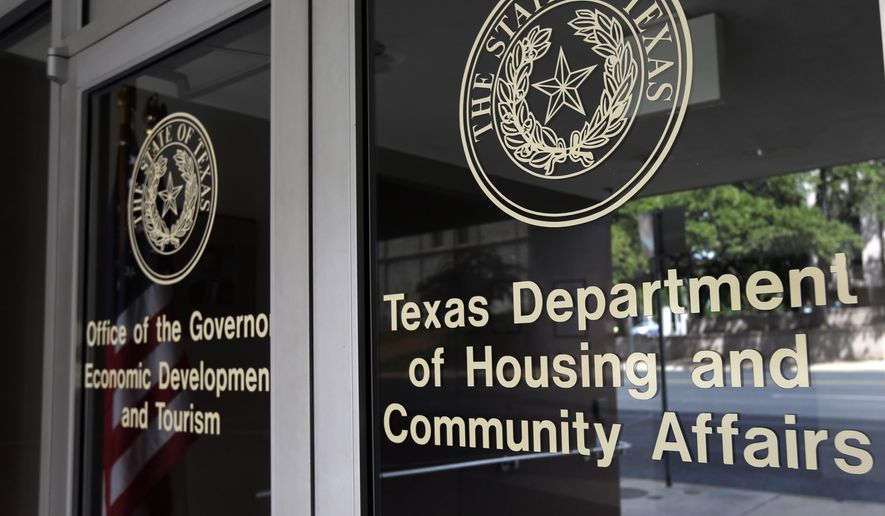 FILE - This Aug. 30, 2014, photo shows the Texas Department of Housing and Community Affairs in Austin, Texas.  The Obama administration may need the vote of a frequent conservative antagonist on the Supreme Court to preserve a decades-old strategy for fighting housing discrimination. Justice Antonin Scalia on Wednesday, Jan. 21, 2015, appeared at times to side with the administration and civil rights groups during arguments over the reach of the landmark Fair Housing Act of 1968, a case that otherwise seemed to split the court along ideological lines. Scalia seemed to agree with the court's four liberal justices that the law can be used to ban housing or lending practices without any proof of intent to discriminate. The court is considering a challenge from Texas officials to the use of so-called disparate impact lawsuits, which allege that even race-neutral lending or housing policies can have a harmful effect on minority groups.(AP Photo/Eric Gay, File)