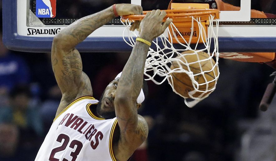 Cleveland Cavaliers' LeBron James dunks against the Utah Jazz during the second quarter of an NBA basketball game Wednesday, Jan. 21, 2015, in Cleveland. (AP Photo/Mark Duncan)