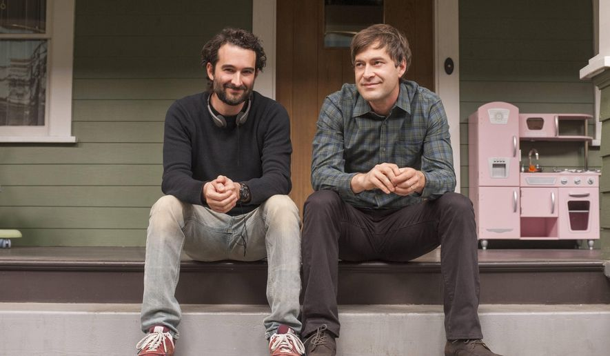 """This image released by HBO shows brothers Jay Duplass, left, and Mark Duplass on the set of """"Togetherness,"""" a series airing Sundays at 9:30 p.m. EST.  (AP Photo/HBO, Prashant Gupta)"""