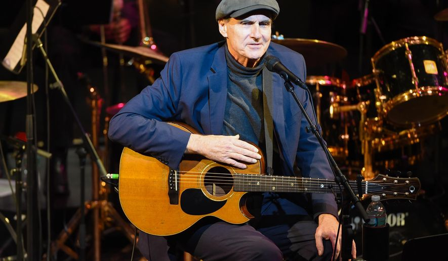 James Taylor performs at the Nearness of You concert at Frederick P. Rose Hall, Jazz at Lincoln Center on Tuesday, Jan. 20, 2015, in New York. (Photo by Scott Roth/Invision/AP)
