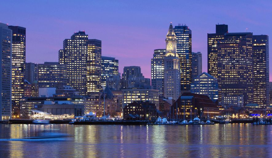 FILE - In this Jan. 6, 2012 file photo, the Boston city skyline is illuminated at dusk as it reflects off the waters of Boston Harbor. Boston residents will get their first chance on Wednesday, Jan. 21, 2015 to see how Olympic planners would handle the 2024 Summer Games if they come to the city. Local bid organizers are planning a public encore for the presentation that won over the USOC last month. (AP Photo/Michael Dwyer, File)