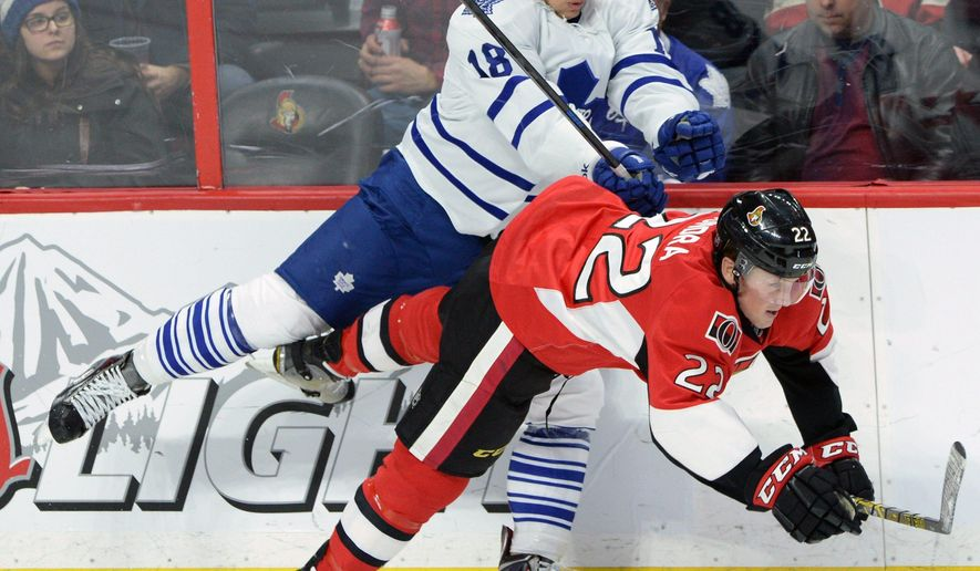 Ottawa Senators' Erik Condra (22) dgets shoved to the ice by Toronto Maple Leafs' Richard Panik during second period NHL hockey action in Ottawa, Ontario, on Wednesday, Jan 21, 2015. (AP Photo/The Canadian Press, Sean Kilpatrick)