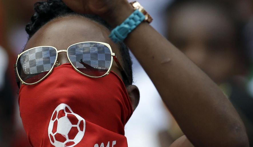 Equatorial Guinea's soccer fan gestures during the African Cup of Nations Group A soccer match between Equatorial Guinea and Burkina Faso in Bata, Equatorial Guinea, Wednesday, Jan. 21, 2015. (AP Photo/Themba Hadebe)