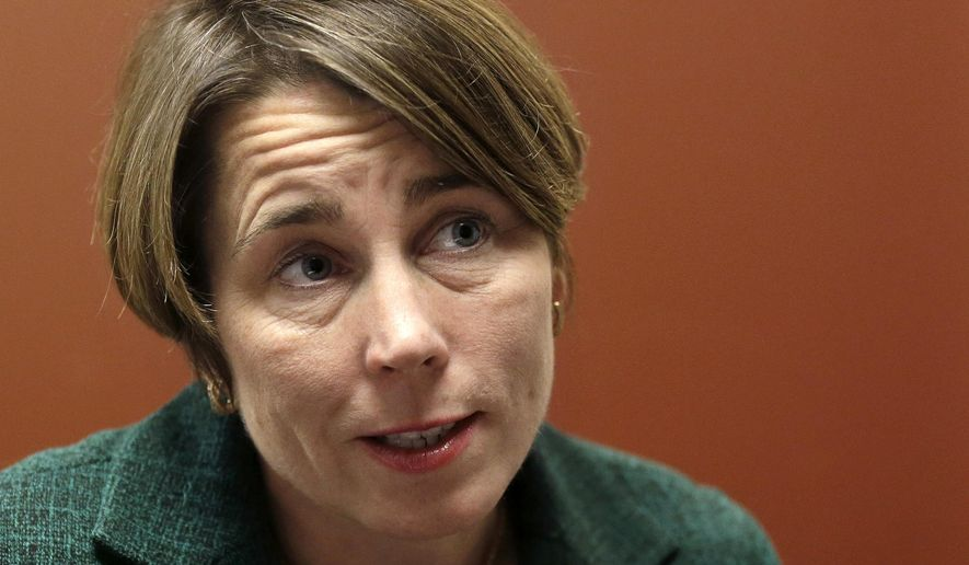 FILE - In this Dec. 15, 2014 file photo, Massachusetts Attorney General-elect Maura Healey speaks during an interview with The Associated Press in Boston. Healey will be sworn in Wednesday, Jan. 21, 2015, becoming the state's 55th attorney general. (AP Photo/Steven Senne, File)