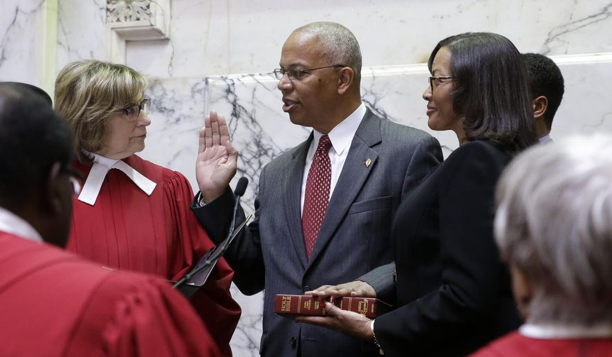 Boyd Rutherford, center, accompanied by his wife Monica, takes the oath of office from from Mary Ellen Barbera, Chief Judge of the Maryland Court of Appeals, to become the Lt. Gov. of Maryland inside the state senate chamber, Wednesday, Jan. 21, 2015, before an inauguration ceremony in Annapolis, Md. (AP Photo/Patrick Semansky, Pool)