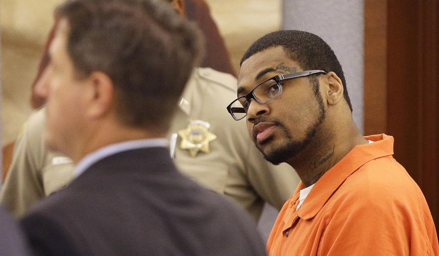 FILE - In this Oct. 1, 2014, file photo, Ammar Harris, right, appears in district court, in Las Vegas. Harris is due to appear Wednesday, Jan. 21, 2015, in Clark County District Court after pleading guilty in October to a felony bribery of a public officer charge. Harris' death penalty trial in the shooting and crash case is scheduled for July. He faces murder, attempted murder and weapon charges in the Feb. 2013 shooting. (AP Photo/John Locher, File)