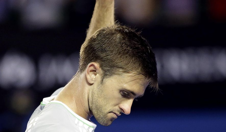 Tim Smyczek of the U.S. waves after his loos to Rafael Nadal of Spain during their second round match at the Australian Open tennis championship in Melbourne, Australia, Wednesday, Jan. 21, 2015. (AP Photo/Lee Jin-man)