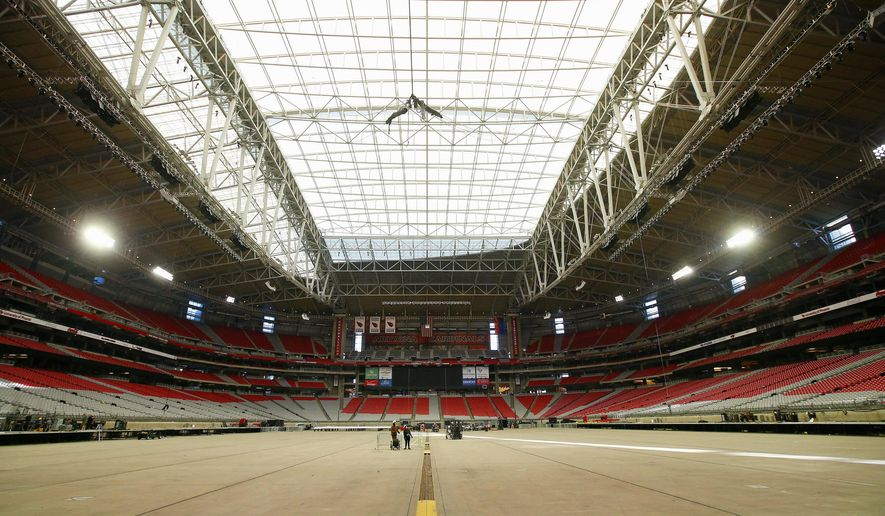 The roof remained closed at University of Phoenix Stadium, where the NFL football's  Super Bowl XLIX will be played, while the grass field remained outside in the sun, Tuesday, Jan. 20, 2015, in Glendale, Ariz.  At this point, the NFL says it plans to keep the retractable roof open at the stadium for the Feb. 1, 2015, NFL championship game between the Seattle Seahawks and New England Patriots, but the plan can change as the league gets a better read on the weather forecast for game night. (AP Photo/Ross D. Franklin)