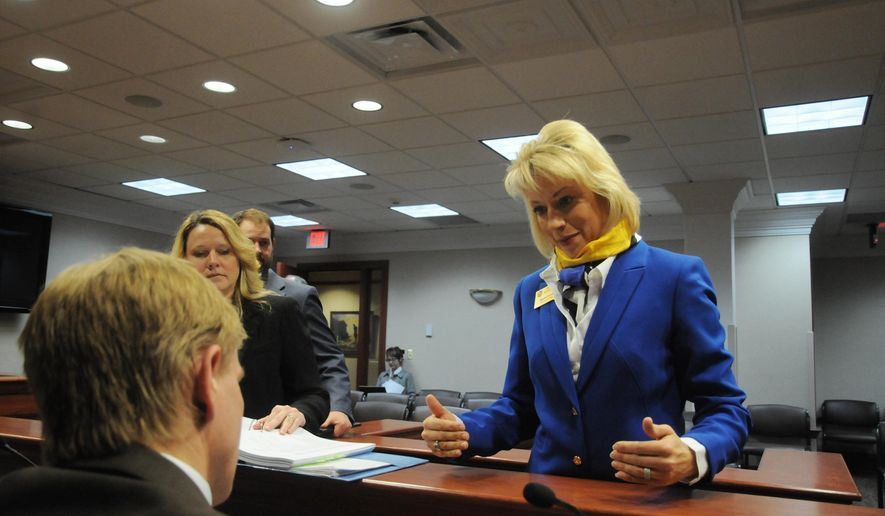 Secretary of State Shantel Krebs speaks to lawmakers after the state Senate Local Government Committee in Pierre, S.D., on Wednesday, Jan. 21, 2015, passed a handful of proposals she is pushing to change election law. (AP Photo/James Nord)