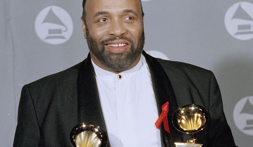 In this March 1, 1995, Andrae Crouch displays his two Grammys backstage at the 37th annual Grammy Awards. Crouch, who died at 72 on Jan. 8, 2015, was remembered Wednesday, Jan. 21, for his dedication to spreading gospel music around the world during a funeral at the West Angeles Church of God in Christ in Los Angeles. (AP Photo/Kevork Djansezian, File)