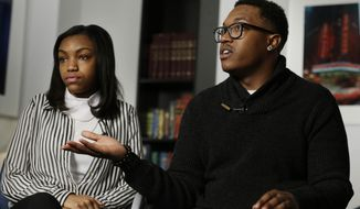 Jamel, right, and Danita McNair, the children of James McNair, are interviewed in New York, Wednesday, Jan. 21, 2015. The family of McNair, a comedian killed in the crash that seriously injured Tracy Morgan last summer, has settled a wrongful death claim with Wal-Mart, an attorney representing the family said. (AP Photo/Seth Wenig)