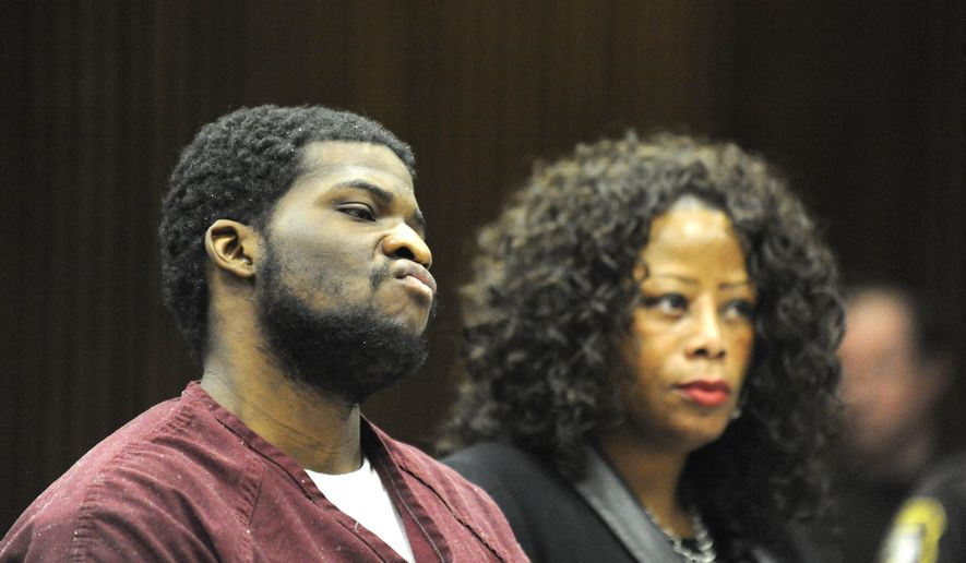 Felando D. Hunter stands with his attorney Coral Watt for his sentencing on Wednesday, Jan. 21, 2015 in Detroit.  Hunter and Frederick Young  convicted in the 2012 slayings of two suburban Detroit teens who authorities say went into the city to buy drugs have been sentenced to life in prison without parole. Young and Hunter  were convicted in December of first-degree murder, torture and armed robbery in the deaths of 17-year-old Jourdan Bobbish and 18-year-old Jacob Kudla of Westland.  (AP Photo/Detroit News, David Coates)  DETROIT FREE PRESS OUT; HUFFINGTON POST OUT
