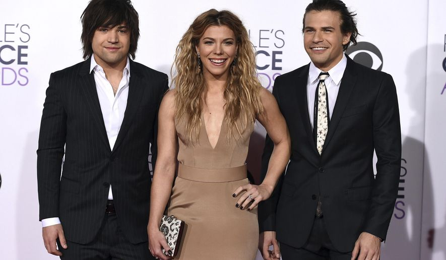 FILE - In this Jan. 7, 2015 file photo, Reid Perry, from left, Kimberly Perry and Neil Perry of The Band Perry arrive at the People's Choice Awards at the Nokia Theatre in Los Angeles. The Band Perry will be among the headline entertainers for this year's Norsk Hostfest in Minot, N.D., running from Sept. 29 through Oct. 3. The annual Hostfest is billed as the largest Scandinavian heritage festival in North America. (Photo by Jordan Strauss/Invision/AP)
