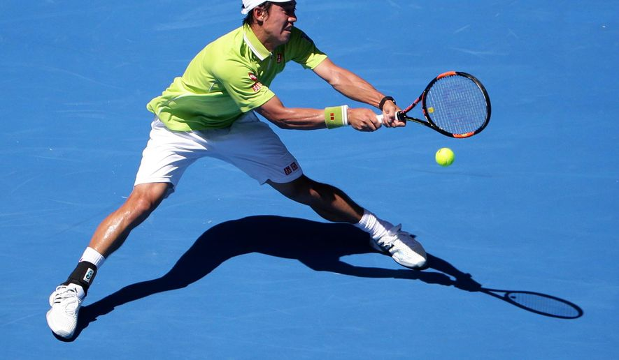 Kei Nishikori of Japan makes a backhand return during his second round match against Ivan Dodig of Croatia at the Australian Open tennis championship in Melbourne, Australia, Thursday, Jan. 22, 2015. (AP Photo/Rob Griffith)