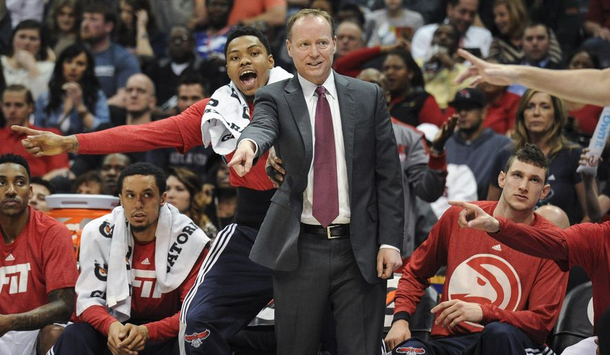 Atlanta Hawks coach Mike Budenholzer, right, and guard Kent Bazemore petition for a call from a referee during the first half of an NBA basketball game against the Indiana Pacers, Wednesday, Jan. 21, 2015, in Atlanta. (AP Photo/John Amis)