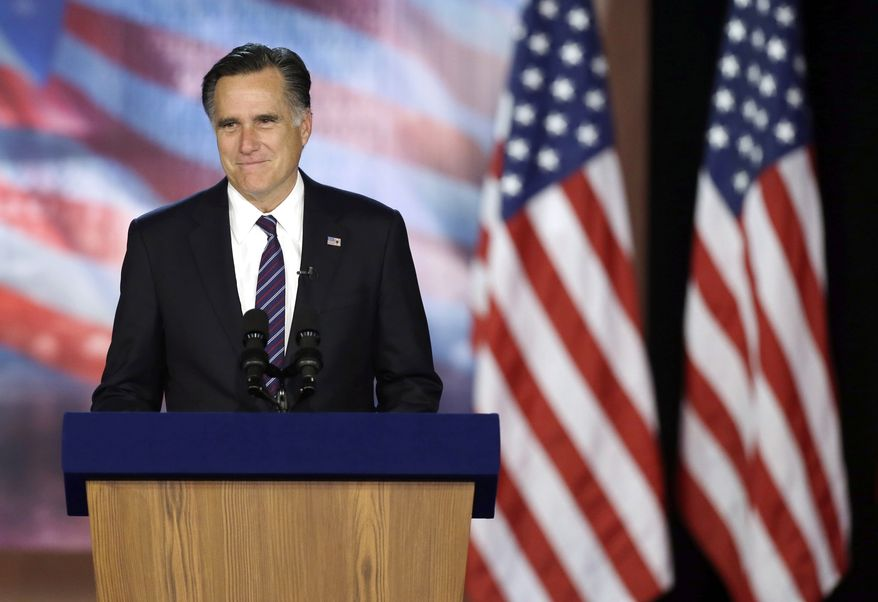 Former Massachusetts Gov. Mitt Romney pauses as he addresses supporters during his election night rally, Wednesday, Nov. 7, 2012, in Boston. (AP Photo/Elise Amendola)