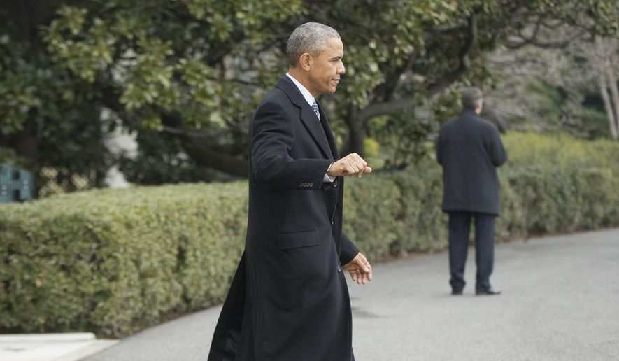 President Barack Obama gestures as he walks out of the White House in Washington, Wednesday, Jan. 21, 2015, toward Marine One before his departure from the South Lawn to Andrews Air Force Base, Md., before heading to Idaho.  (AP Photo/Pablo Martinez Monsivais)