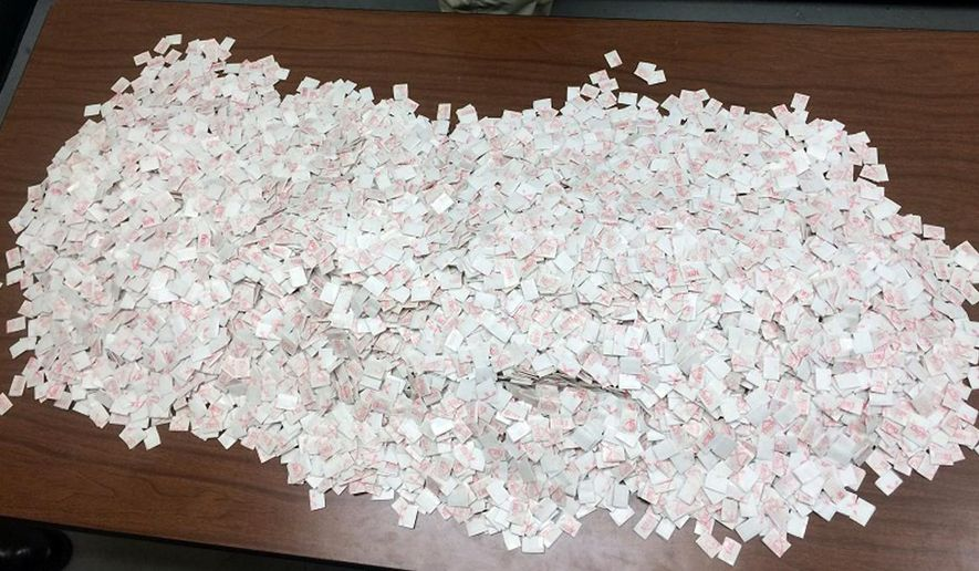 This photo taken Tuesday, Jan. 20, 2015, and provided by Delaware State Police shows what they say are 15,000 packets of heroin found in the car of Davon Tucker, of Paterson, N.J., during a traffic stop in Milton, Del. (Associated Press/Delaware State Police) **FILE**