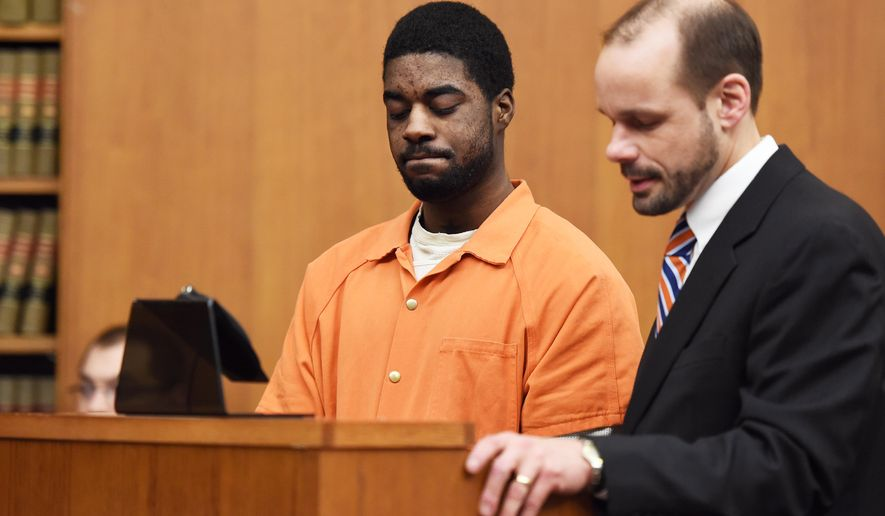 Shaquille Jones stands at the podium with his attorney James Fifelski during his sentencing, Wednesday, Jan. 21, 2015 at the Washtenaw County Trial court in Ann Arbor, Mich., in the murder of University of Michigan medical student Paul DeWolf. Jones, who pleaded guilty Jan. 12 to second-degree murder for his involvement in the 2013 shooting death of DeWolf, was sentenced to 25 to 50 years in prison. (AP Photo/The Ann Arbor News, Melanie Maxwell) LOCAL TELEVISION OUT; LOCAL INTERNET OUT
