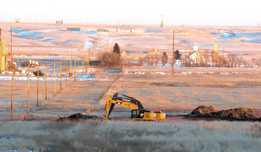 In this photo taken Jan. 12, 2015, crews dig up land at a saltwater spill site near Blacktail Creek outside Williston, N.D. A North Dakota health official called the 70,000 barrel spill the state's largest during the state's current oil boom. (AP Photo/Williston Herald, Zack Nelson)