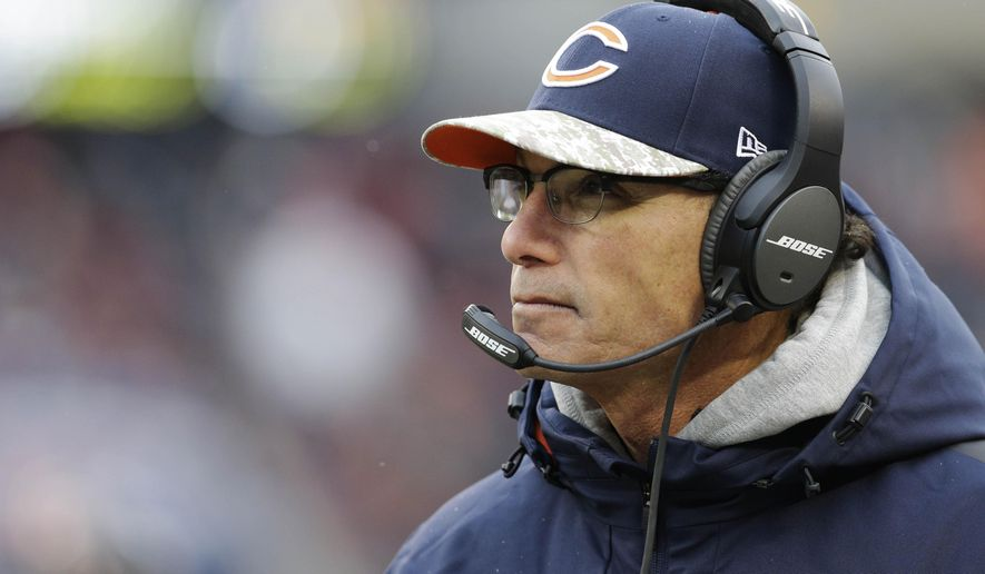 FILE - In this Nov. 16, 2014, file photo, then-Chicago Bears head coach Marc Trestman watches his team during the first half of an NFL football game against the Minnesota Vikings in Chicago. Trestman was hired Tuesday, Jan. 20, 2015,  as offensive coordinator of the Baltimore Ravens, 22 days after being fired as coach of the Bears. (AP Photo/Nam Y. Huh, File)