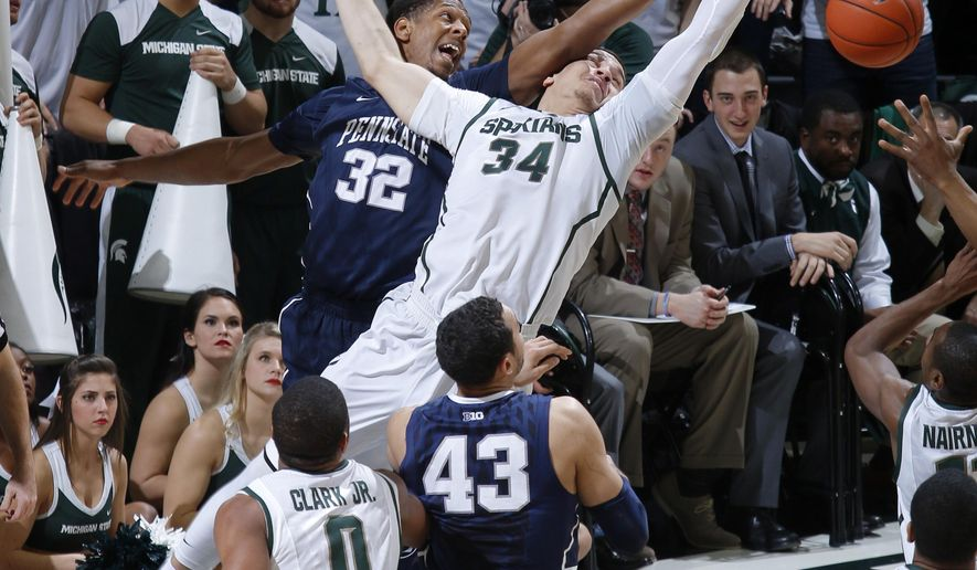 Michigan State's Gavin Schilling (34) and Penn State's Jordan Dickerson (32) try for a rebound during the first half of an NCAA college basketball game, Wednesday, Jan. 21, 2015, in East Lansing, Mich. Watching are Michigan State's Marvin Clark Jr. (0) and Penn State's Ross Travis (43) (AP Photo/Al Goldis)