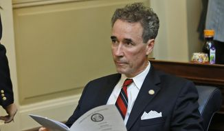 Del. Joe Morrissey, I-Henrico, looks over the calendar during the House session at the Capitol in Richmond, Va., Wednesday, Jan. 21, 2015. (AP Photo/Steve Helber)