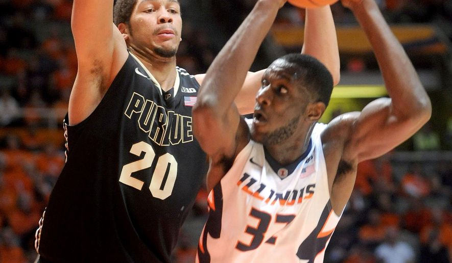 Purdue's A.J. Hammons (20) defends Illinois' Nnanna Egwu (32) during the first half of an NCAA college basketball game Wednesday, Jan. 21, 2015, in Champaign, Ill. (AP Photo/Heather Coit)