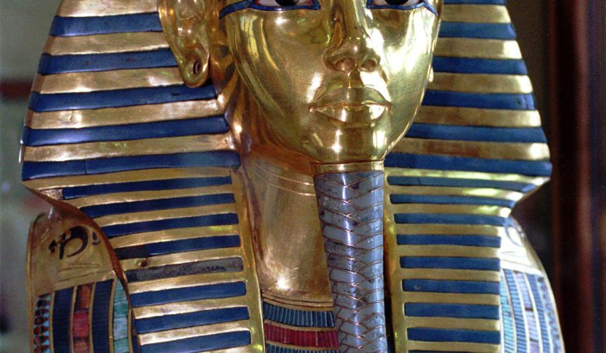 FILE - This July 1996 photo shows the mask of King Tutankhamun at the Egyptian Museum in Cairo. On Wednesday, Jan. 21, 2014, conservators at the museum say the blue and gold braided beard on the artifact was hastily glued back on with epoxy after it was detached during a cleaning. (AP Photo/Mohamed El-Dakhakhny)
