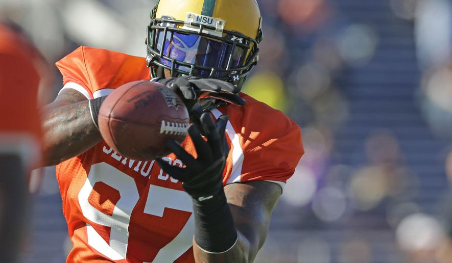 Norfolk State outside linebacker Lynden Trail of  (97) catches a ball during a drill during NCAA college football practice for the Senior Bowl, Wednesday, Jan. 21, 2015, at Ladd-Peebles Stadium in Mobile, Ala. (AP Photo/Brynn Anderson)