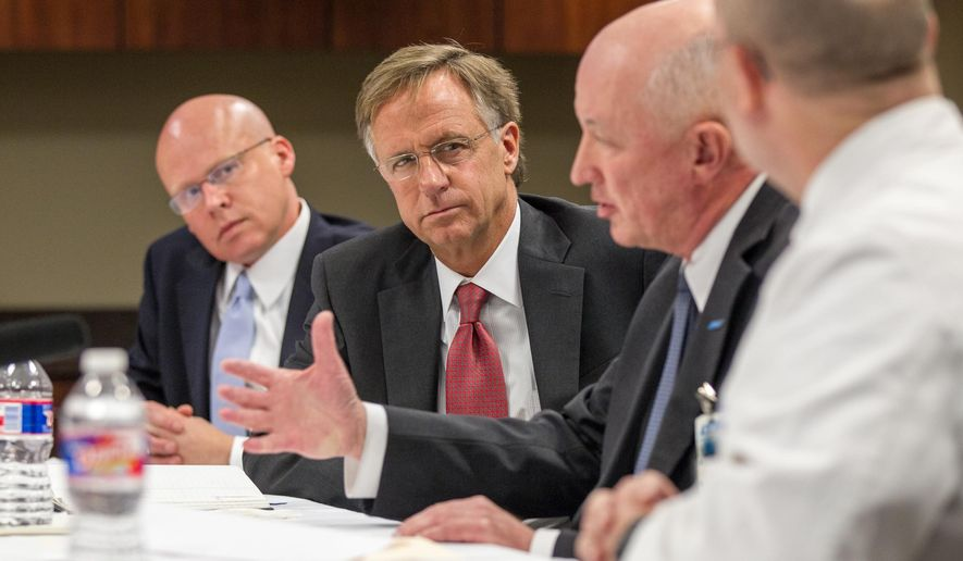 Republican Gov. Bill Haslam, second from left, attends a meeting at Jackson-Madison County General Hospital in Jackson, Tenn., about his proposal to extend health coverage to 200,000 low-income Tennesseans, on Wednesday, Jan. 21, 2015. It was the first of a series of discussions the governor plans to hold around the state before a Feb. 2 special session of the Legislature to take up the measure. (AP Photo/Erik Schelzig)