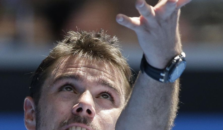 Stan Wawrinka of Switzerland serves to Marius Copil of Romania during their second round match at the Australian Open tennis championship in Melbourne, Australia, Thursday, Jan. 22, 2015. (AP Photo/Lee Jin-man)