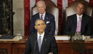 President Barack Obama pauses during his State of the Union address before a joint session of Congress on Capitol Hill in Washington, Tuesday, Jan. 20, 2015. Vice President Joe Biden and House Speaker John Boehner of Ohio listen.  (AP Photo/J. Scott Applewhite)