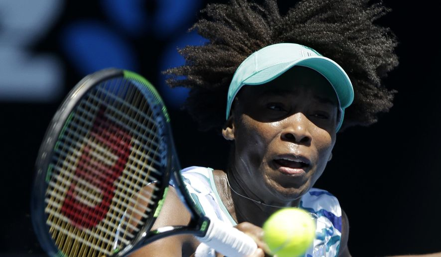 Venus Williams of the U.S. makes a forehand return to compatriot Lauren Davis during their second round match at the Australian Open tennis championship in Melbourne, Australia, Thursday, Jan. 22, 2015. (AP Photo/Lee Jin-man)