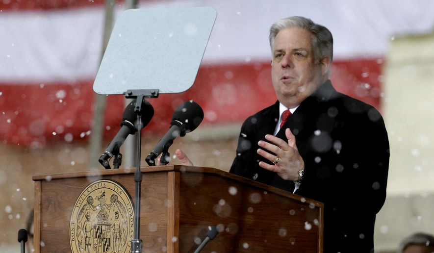 Maryland Gov. Larry Hogan delivers remarks as snow falls during inaugural ceremonies at the statehouse, Wednesday, Jan. 21, 2015, in Annapolis, Md. Hogan is the 62nd governor of Maryland. (AP Photo/Patrick Semansky)