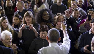 President Barack Obama greets people after speaking to a capacity crowd at the Caven-Wiliams Sports Complex at Boise State University, Wednesday Jan. 21, 2015 in Boise, Idaho. (AP Photo/Idaho Statesman, Darin Oswald)