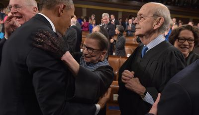US President Barak Obama embraces US Supreme Court Justice Ruth Bader Ginsburg as US Supreme Court Justices Anthony M. Kennedy (L), Stephen G. Breyer (2nd R) and Sonia Sotomayor (R) look on before the President's State Of The Union address on January 20, 2015 at the US Capitol in Washington, DC. AFP PHOTO/POOL/MANDEL NGAN