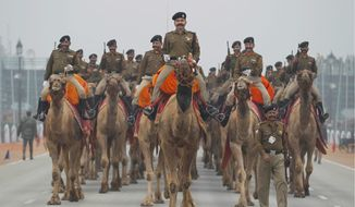 """Indian soldiers rehearse for the Republic Day parade in New Delhi, where President Obama will be the """"chief guest."""" The unprecedented invitation to the U.S. president is part of Indian Prime Minister Naredra Modi's aggressive diplomacy. (Associated Press)"""